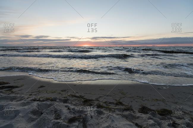 Sandy coastalbeachof Baltic Sea at sunset