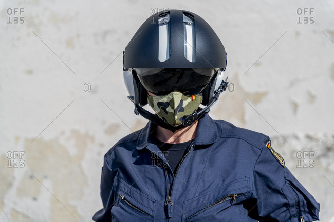 Female police pilot wearing helmet and protective face mask