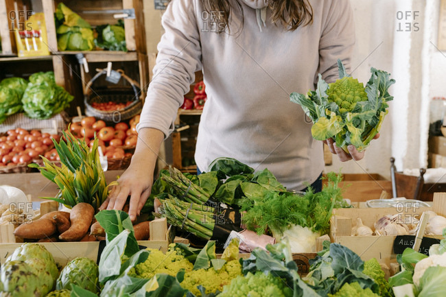 Woman picking fresh healthy vegetable at store