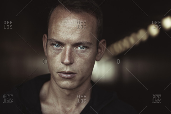 Close-up of man with gray eyes in tunnel