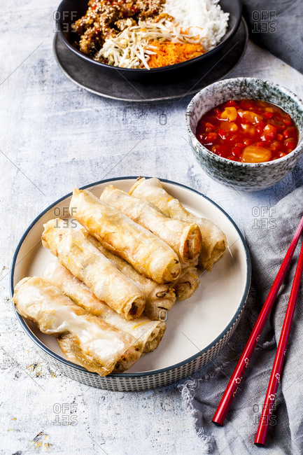 Homemade spring rolls and bowl of dipping sauce