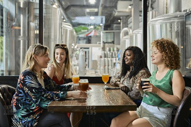 Female friends socializing in a pub
