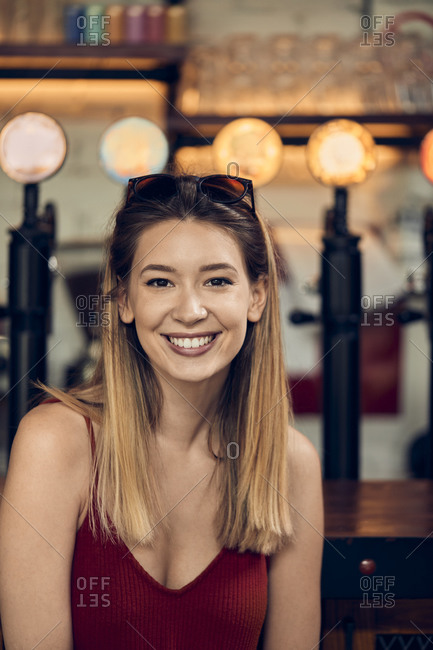Portrait of a smiling woman in a pub