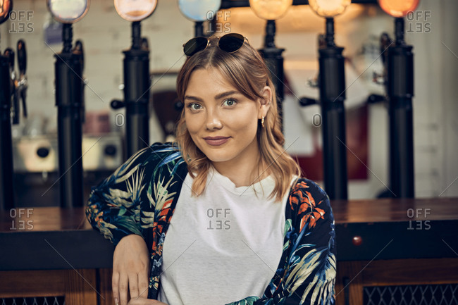 Portrait of a confident woman in a pub