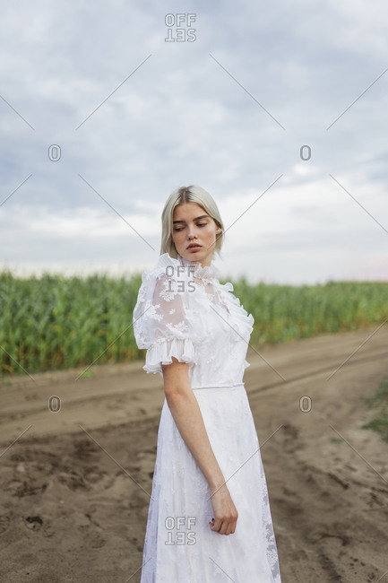 Woman in white dress walks in nature