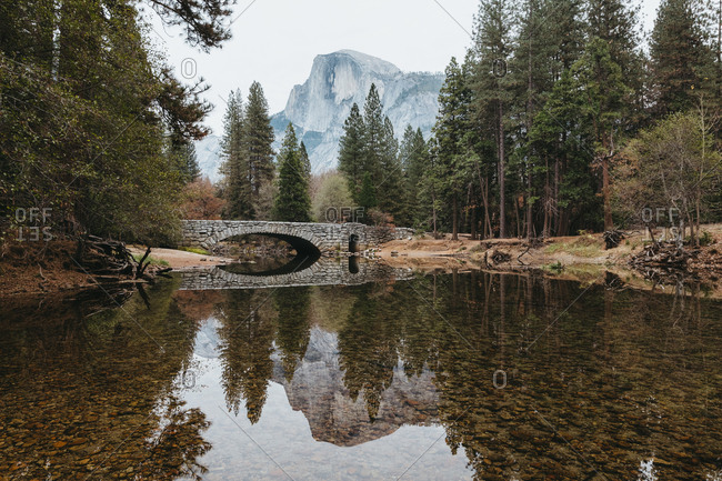 Tranquility on merced river with half dome in distance