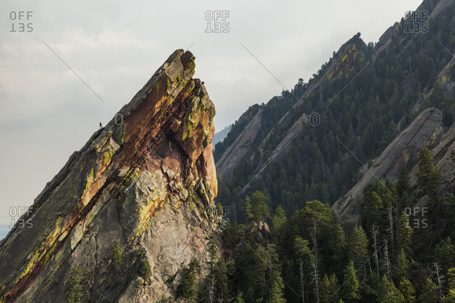 Climber on east face of third flatiron above boulder, colorado