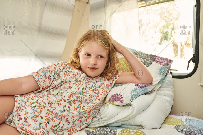 Girl lying in a caravan. she is relaxed on her vacation.