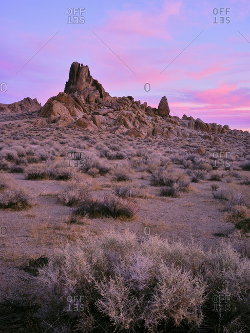 Sunset in the alabama hills, rock formations and cotton candy clouds.