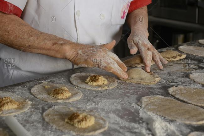 Chef preparing  delicious mexican empanadas