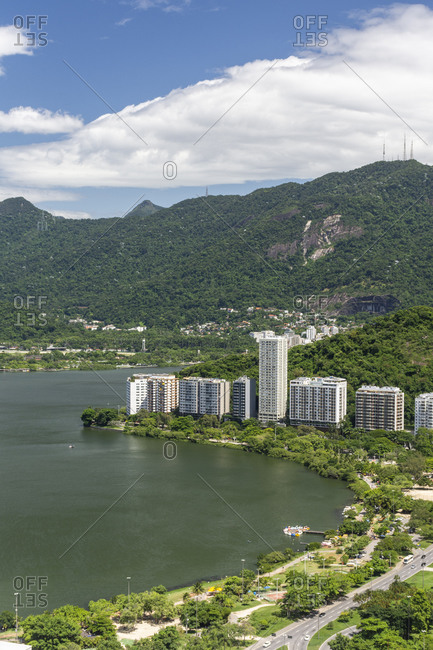 View to residential buildings in lagoa area and green mountains