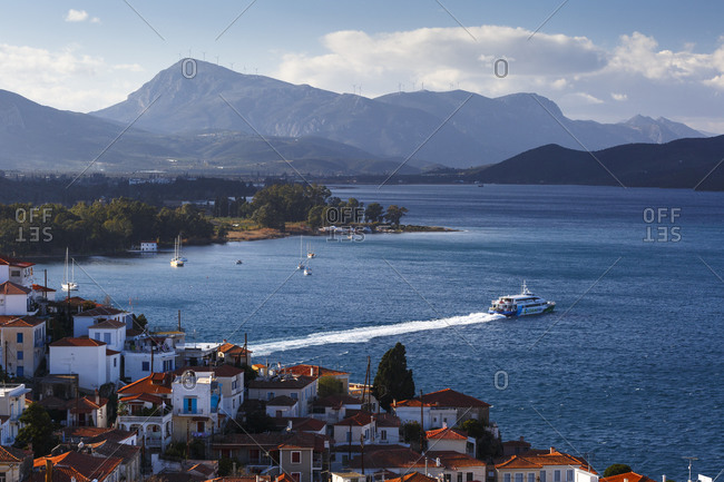 Poros, greece - january 17, 2018: view of the chora village of poros island from a nearby hill, greece.