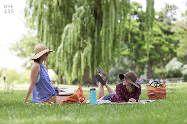 Two women enjoy a park on a sunny day in the columbia gorge.