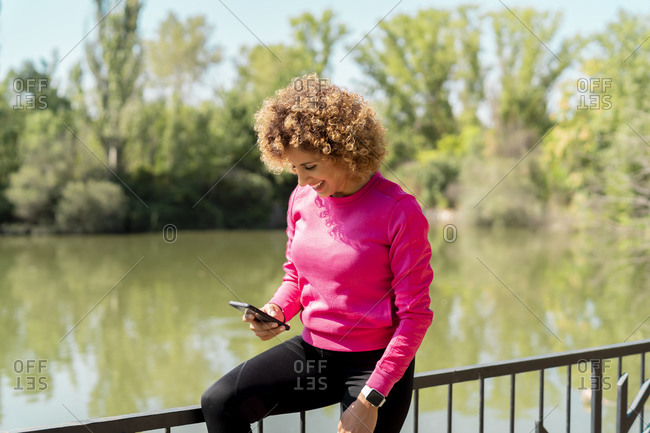 athlete woman using her smartphone