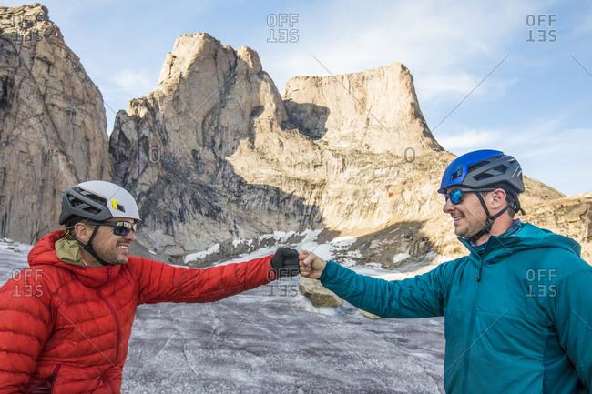Two climber fist bump after a successful climb