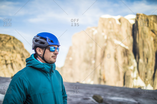 Portrait of climber in mountains wearing blue.