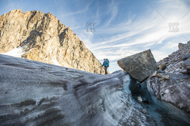 Backpacker crosses glacier in akshayak pass
