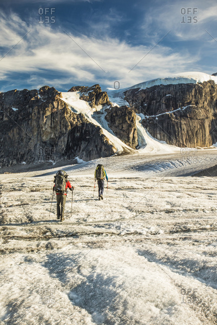Rear view of two mountaineers exploring auyuittuq national park