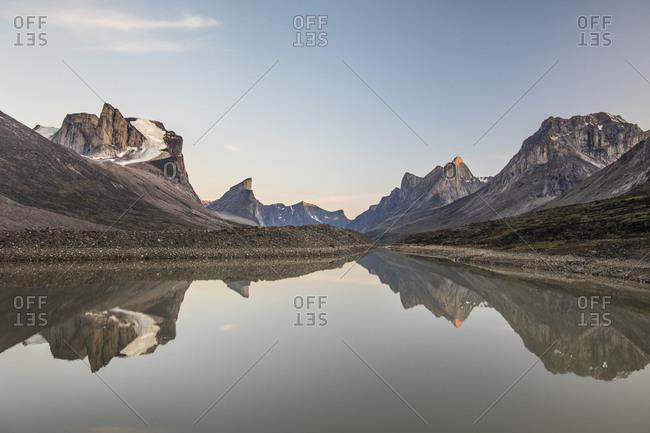 Reflection of mountains in summit lake, akshayak pass