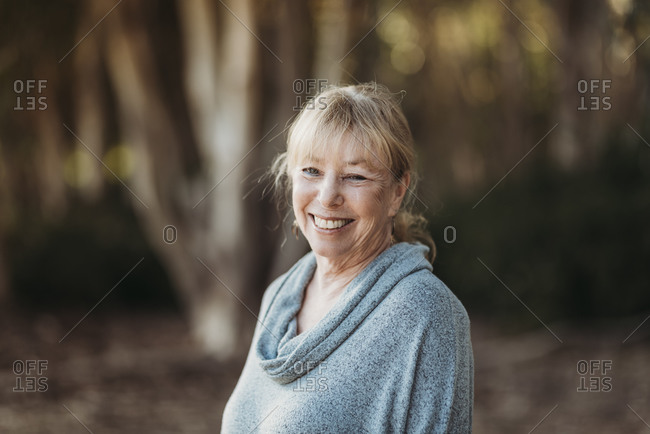 Portrait of Smiling Senior Adult Woman Smiling in Forest