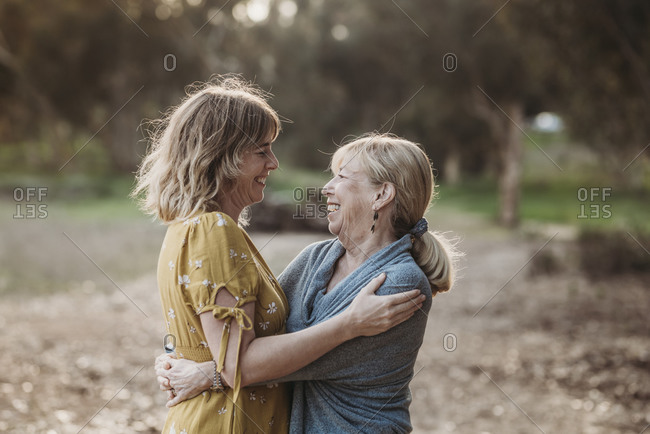 Lifestyle portrait of adult mother and senior mother looking at each o