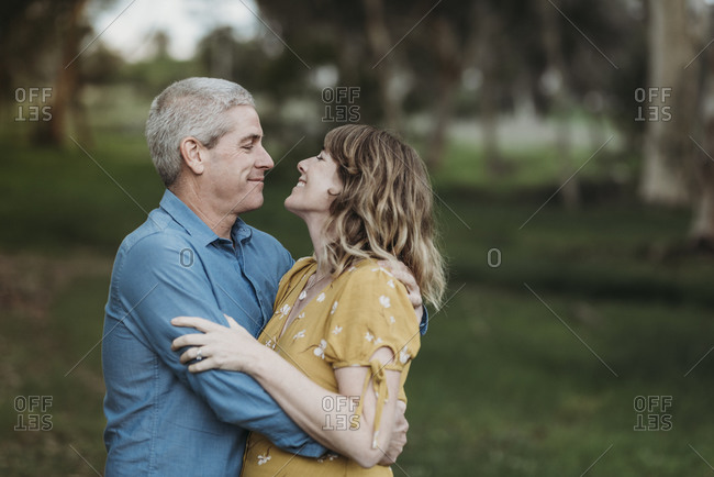 Portrait of married couple closely embracing and looking at each other