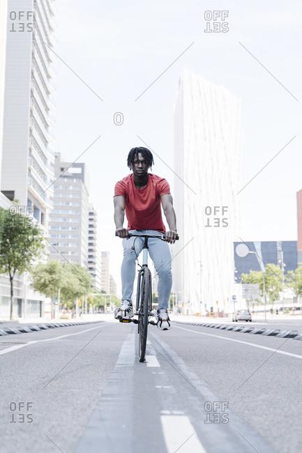 Man riding bicycle on embankment