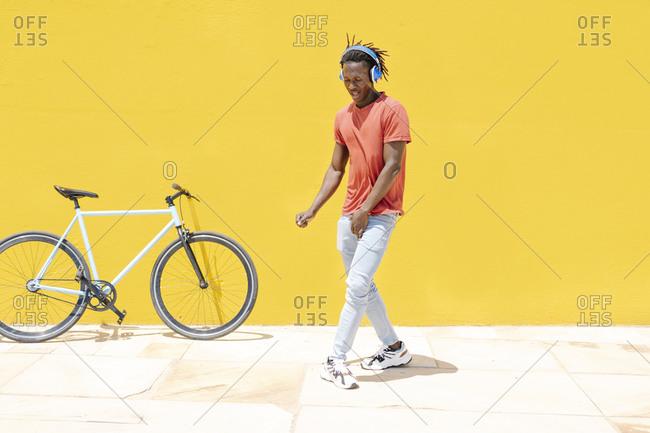 Black guy dancing on street