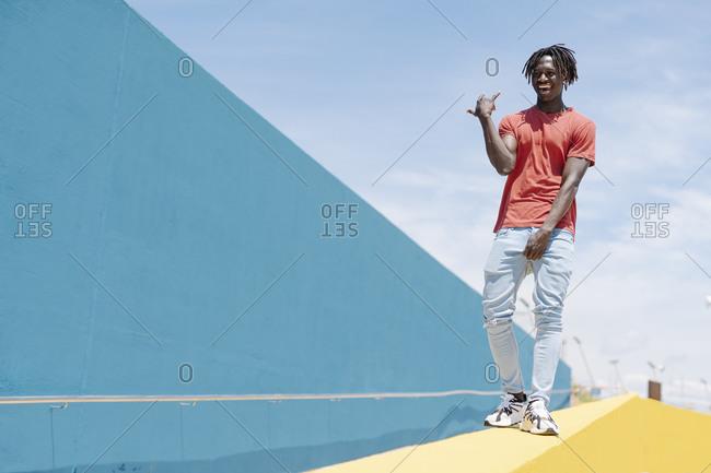 African American male dancing on street