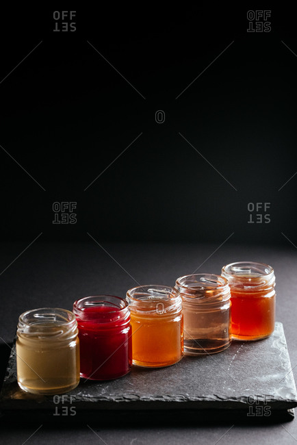 berry tinctures in shorts on black background