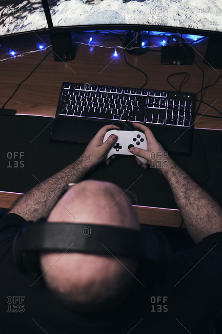 Gamer holding gamepad, controller console in hands. close up.