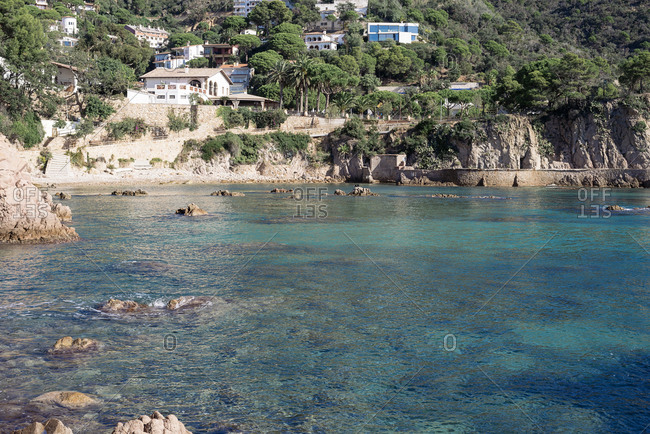 Scenic village with clear blue water in nice bay at costa brava, spain