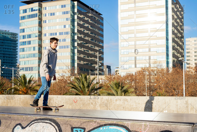 Young skater teen standing on ramp ready to start riding