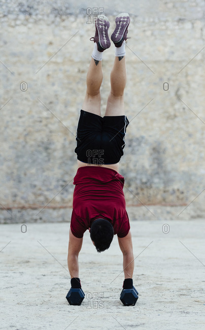 Man standing upright during a crossfit training routine.