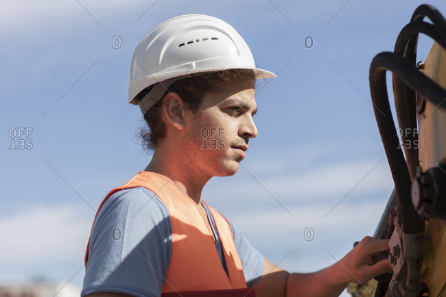Young  engineer  working outside at photo voltaic station