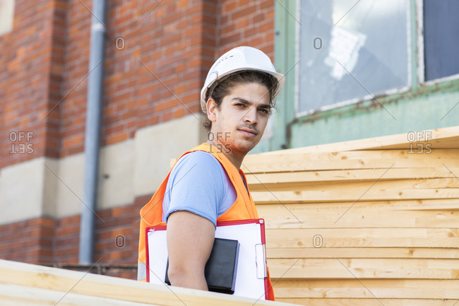 Young construction engineer with helmet working outside