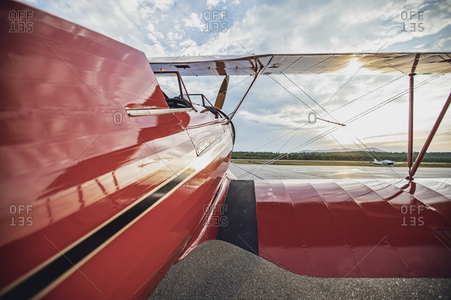 Red vintage antique waco biplane at airport in maine at sunrise