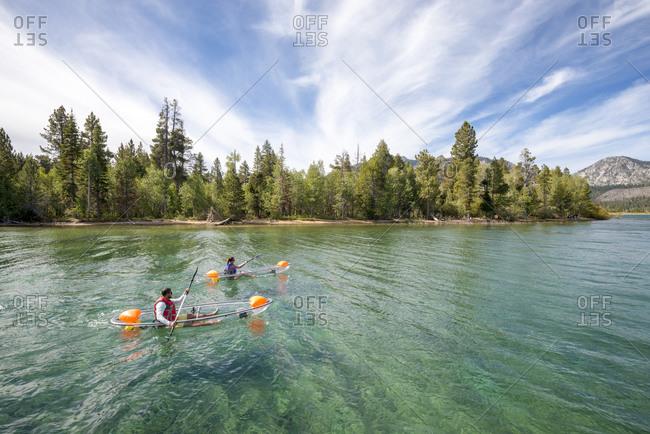 A man and woman kayaking on lake tahoe, ca