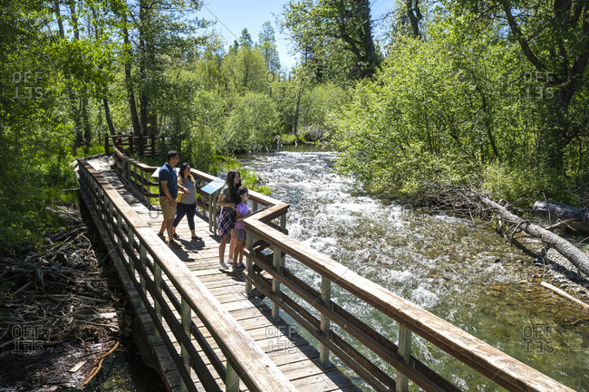 A family enjoys a bike ride on a bike path in south lake tahoe, ca