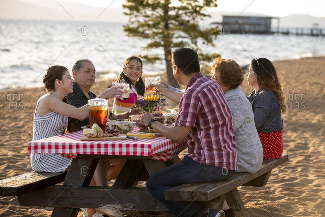 A family enjoys a beach bbq on the shoreline of lake tahoe, nv