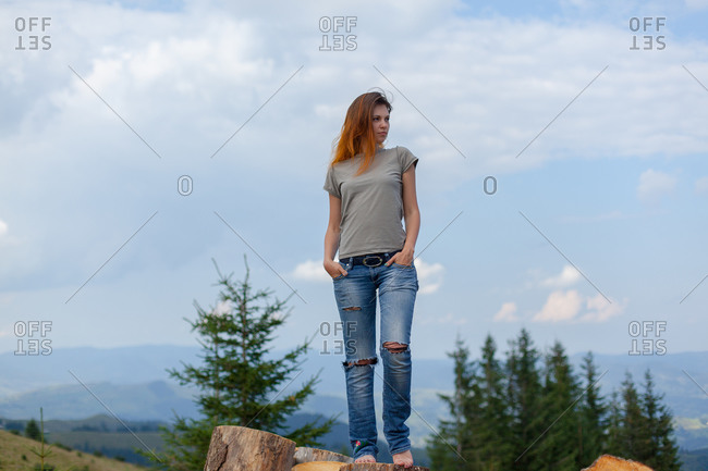 Girl posing and gesturing in the summer high in the carpathian mountains