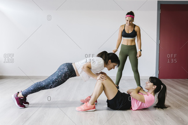 Mother and daughter training together in gym