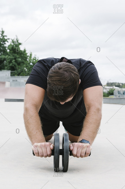 Isolated man working out outdoors