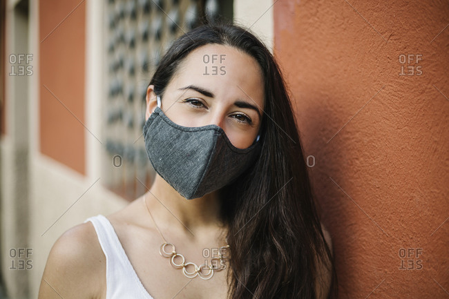 Portrait of woman with crossed arms wearing face mask