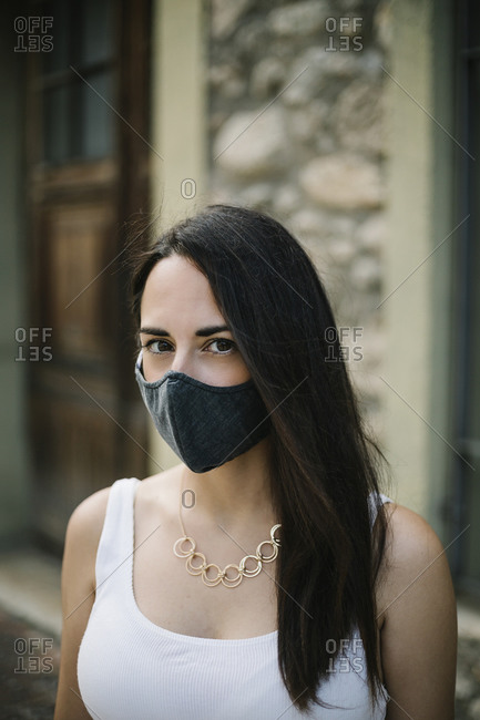 Close-up of woman wearing mask outdoors