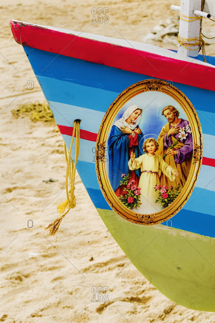 October 17, 2017: Colorful prow of fishing boat with Jesus, Mary, Joseph Christian picture on Marari Beach, Mararikulam, Alappuzha, Kerala, India, Asia