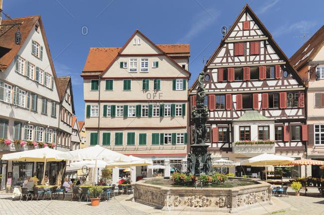 June 3, 2019: Street cafes at Neptunbrunnen fountain, market square, Tubingen, Baden-Wurttemberg, Germany, Europe