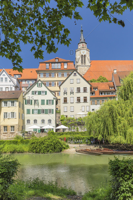 June 3, 2019: Old town with Stiftskirche church reflecting in Neckar river, Tubingen, Baden-Wurttemberg, Germany, Europe