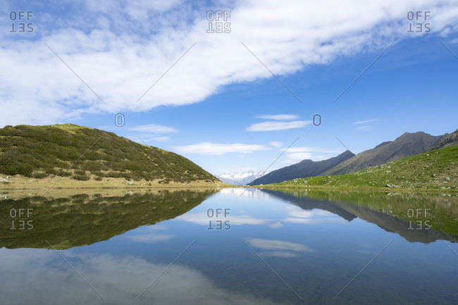 Mountains reflected in the blue water of Porcile Lakes, Tartano Valley, Valtellina, Sondrio province, Lombardy, Italy, Europe
