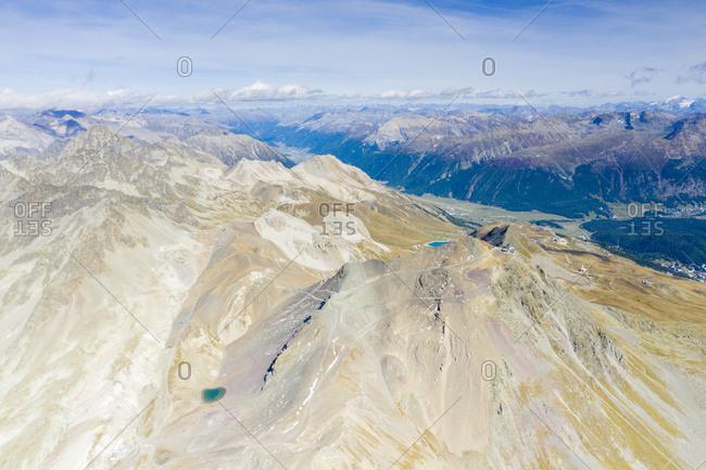 Aerial panoramic by drone of majestic Piz Nair mountain and lake Lej Da La Pesch, Engadine, canton of Graubunden, Switzerland, Europe